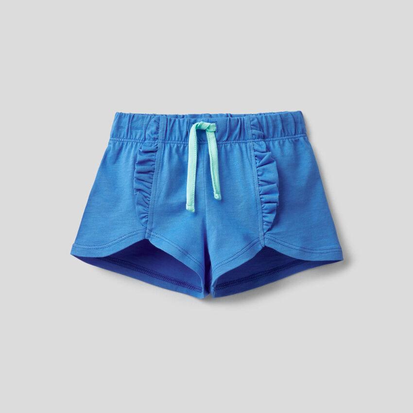 Pantalón corto de 100% algodón con volantes