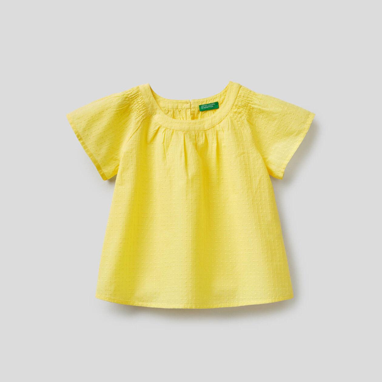 Blusa bordada de 100% algodón